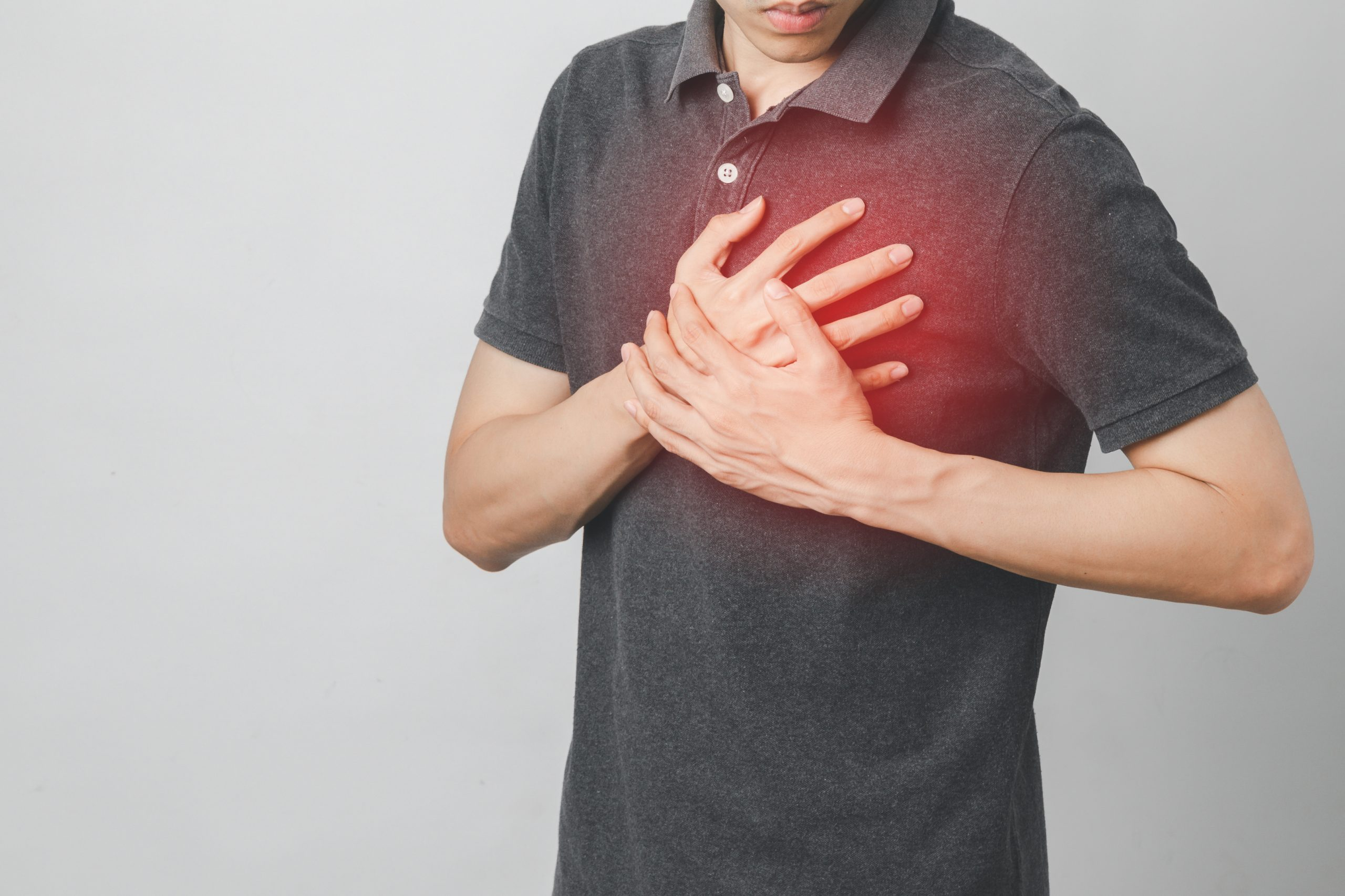 Man has chest pain suffering by heart disease, Cardiovascular disease, heart attack. Health care concept